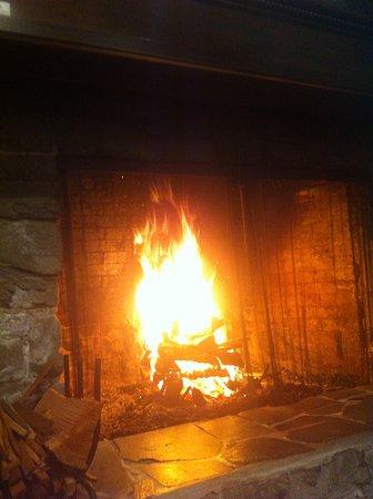 lodge fireplace and blazing