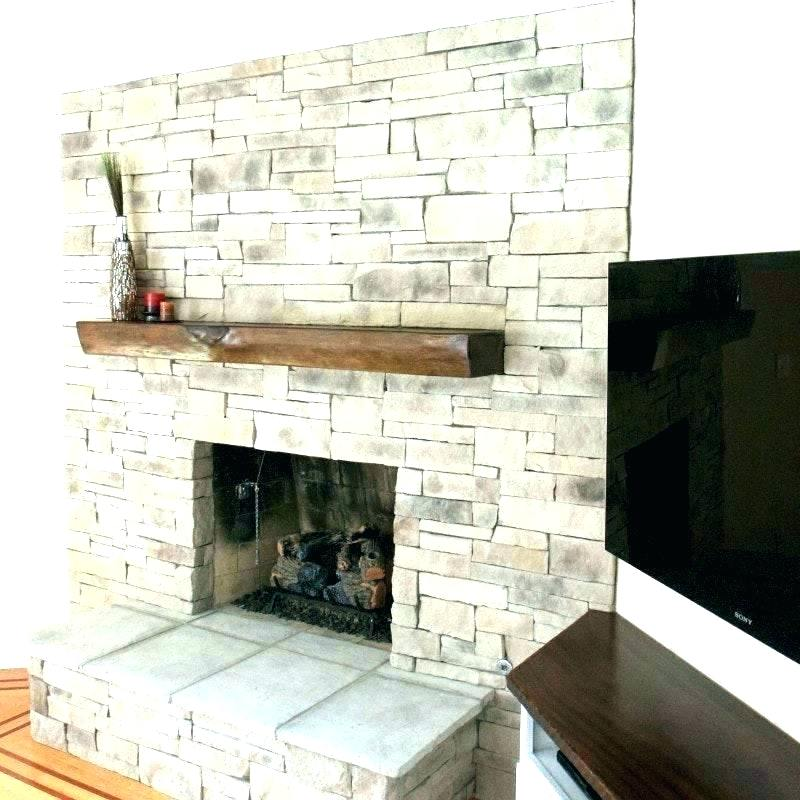 cost of building a stone house stacked fireplace faux surround veneer perfect average bui