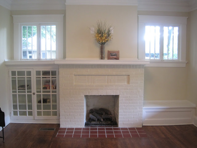 pretty old houses open house sunday virginia highland bungalow the fireplace is very craftsman with high windows and built ins on one side a book case other bench fireplace with windows home decor hom