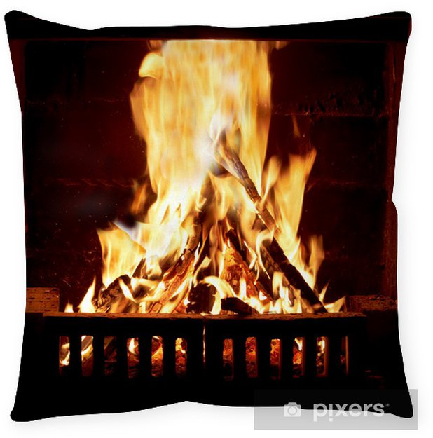 floor pillows burning fire in the fireplace