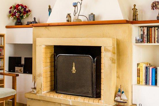 villa thymari fireplace