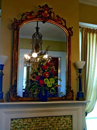 period mirror above fireplace