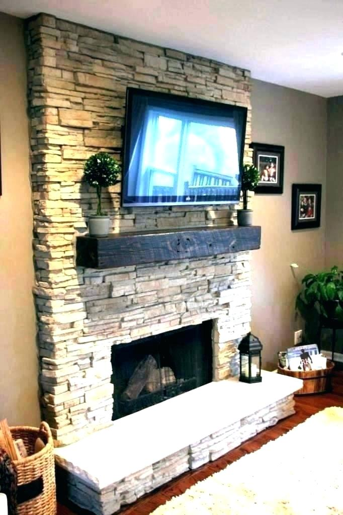 mounting a tv over a fireplace tv over fireplace thenydog mounting tv above fireplace hiding wires uk