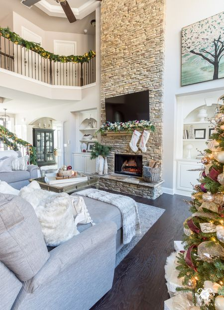 two story living room with stacked stone fireplace 5b7b6c5046e0fb0082f9657f