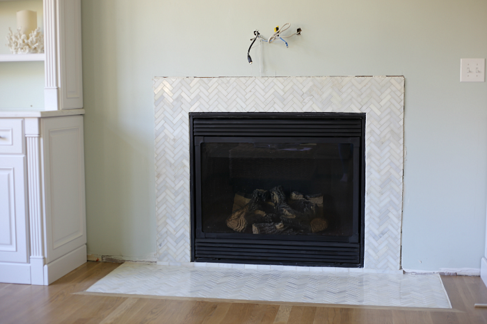 Installing a Marble Herringbone Tile Fireplace Surround and Hearth