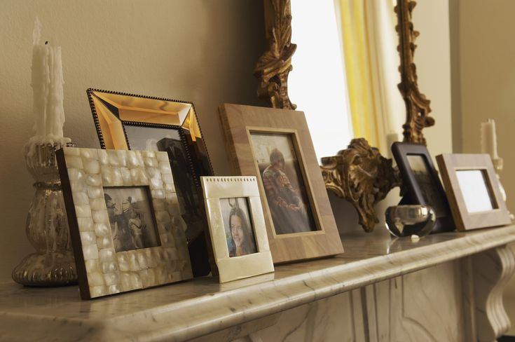 fireplace mantel with framed pictures 5a78fa9aba ce6