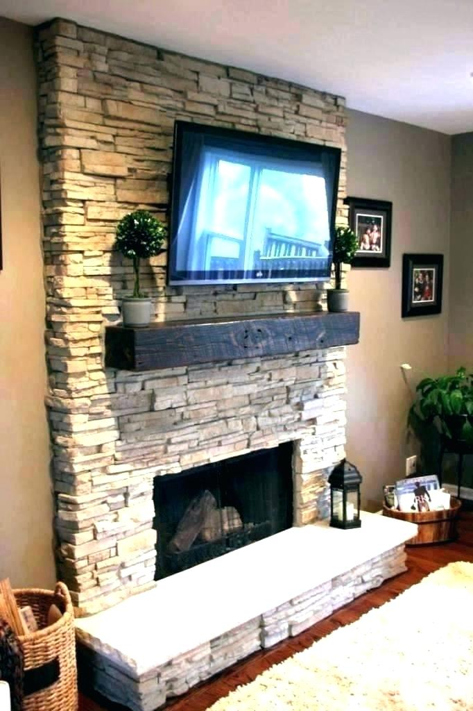 ing fireplace tv wall mount over stone