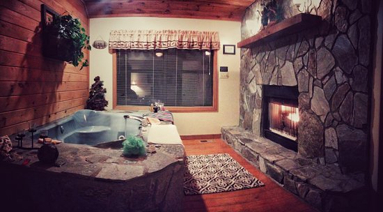 Romantic Getaways with Jacuzzi and Fireplace Elegant Jacuzzi Tub and Fireplace In Elsa Cabin View From Bed