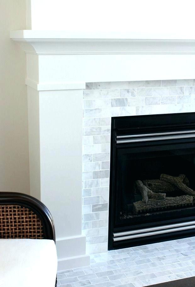 painting tile around fireplace paint fireplace tile plus white painted fireplace with marble subway tile the makeover details for frame painting tile fireplace painting marble tile fireplace