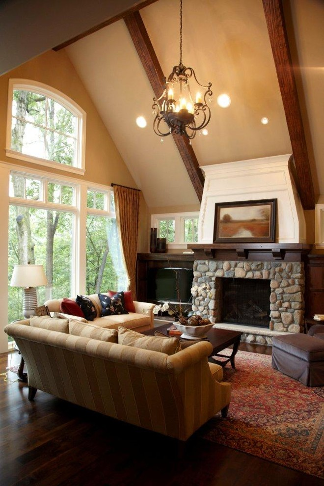 Stone fireplace mantel shelf living room traditional with ceiling lighting sloped ceiling window treatments 11