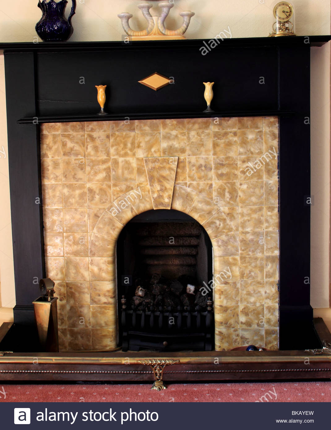 art deco fireplace with wooden surround and period ceramics BKAYEW