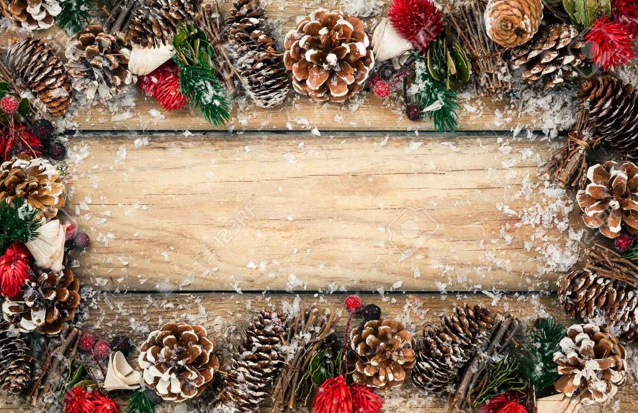 winter background with rustic christmas garland using pine cones dried leaves and berries twigs and