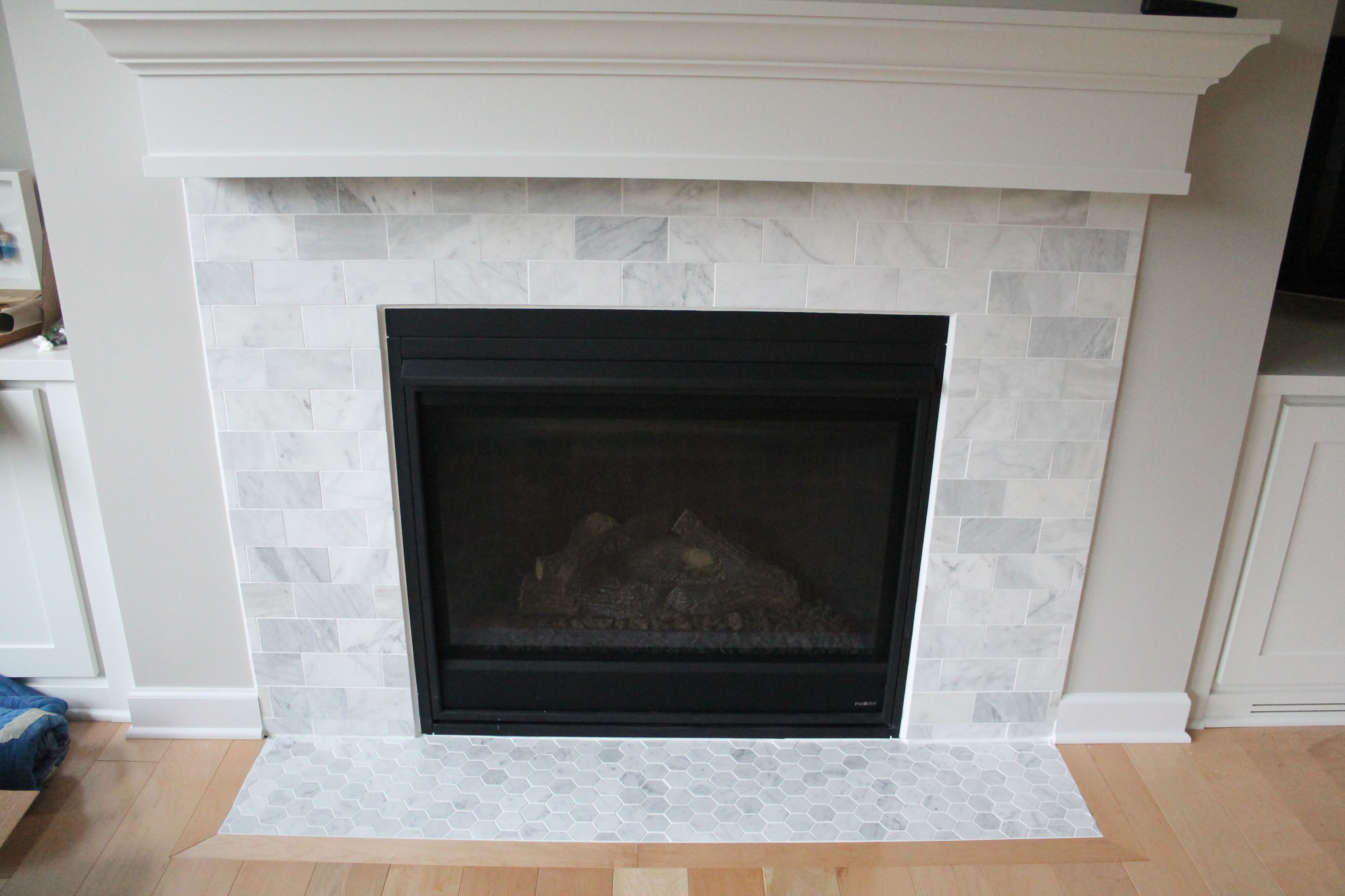1 fin marble subway tile fireplace 5a0c9fa2482c b0a8