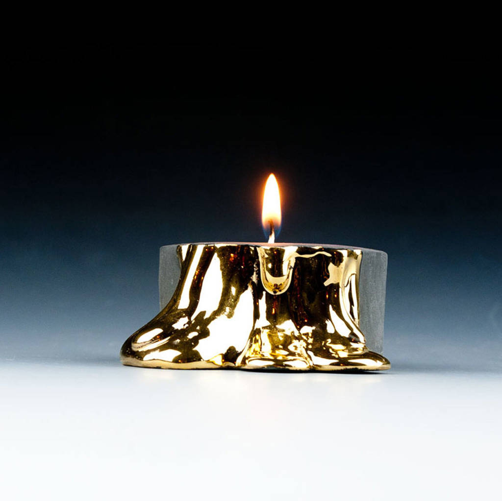 original black candle holders with dripping gols