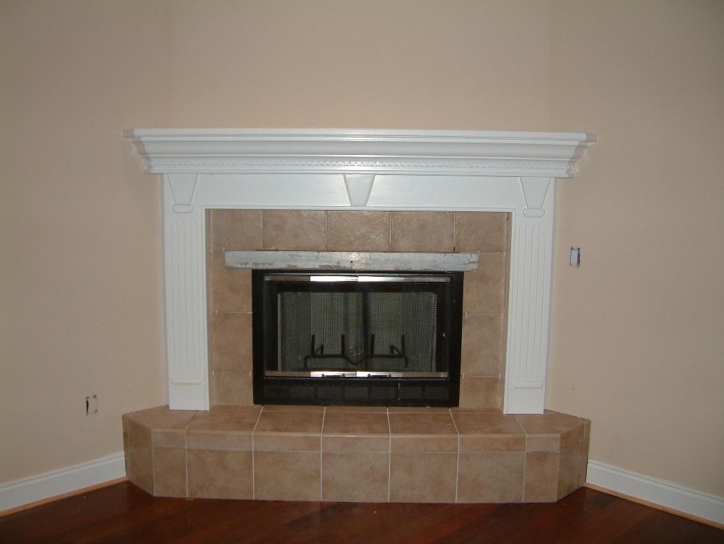 Corner Fireplace Decor with Mirror