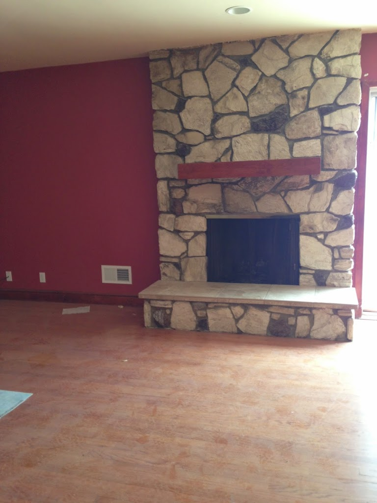 before renovation stone fireplace