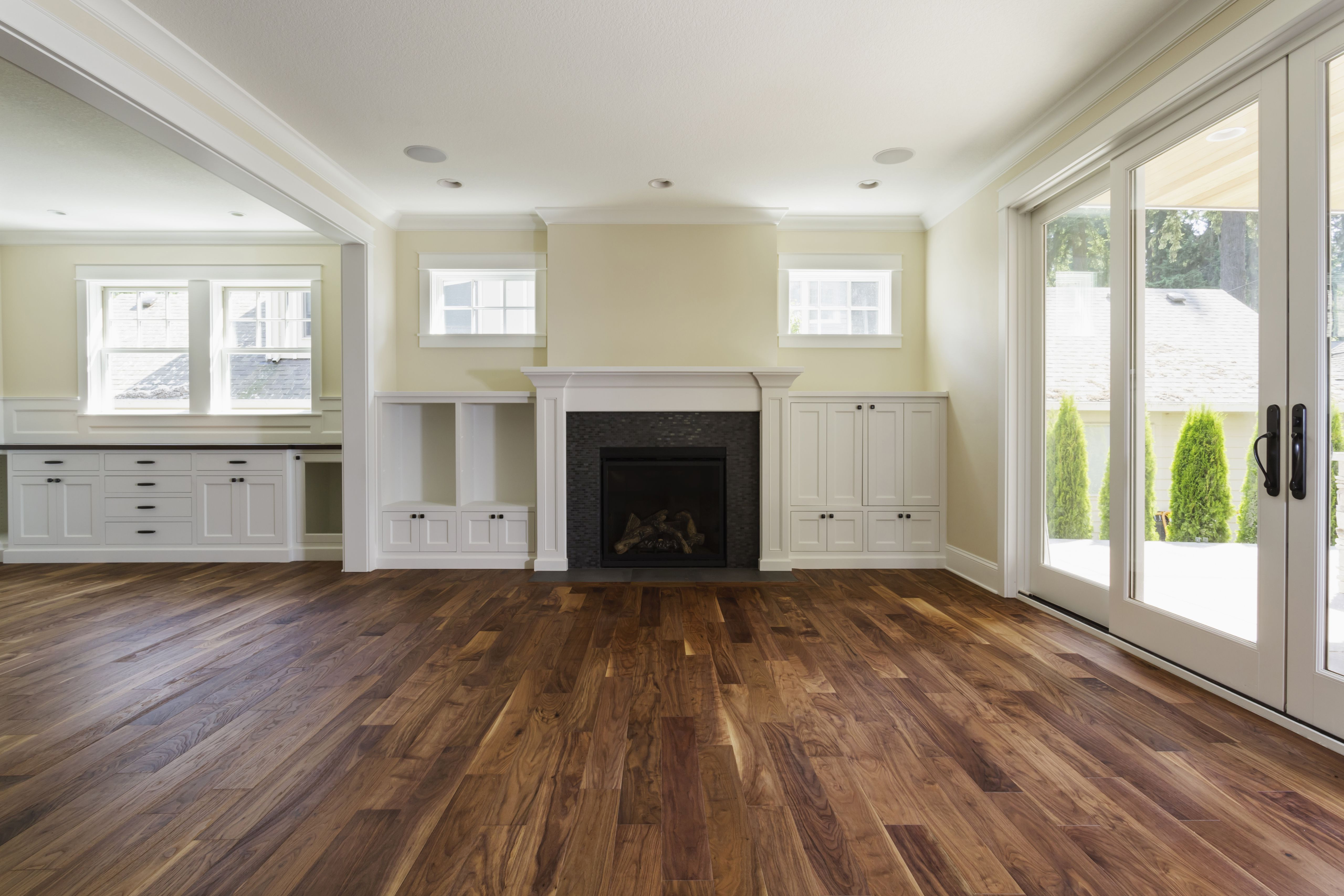 laminate flooring vs engineered hardwood of the pros and cons of prefinished hardwood flooring with fireplace and built in shelves in living room 57bef8e33df78cc16e