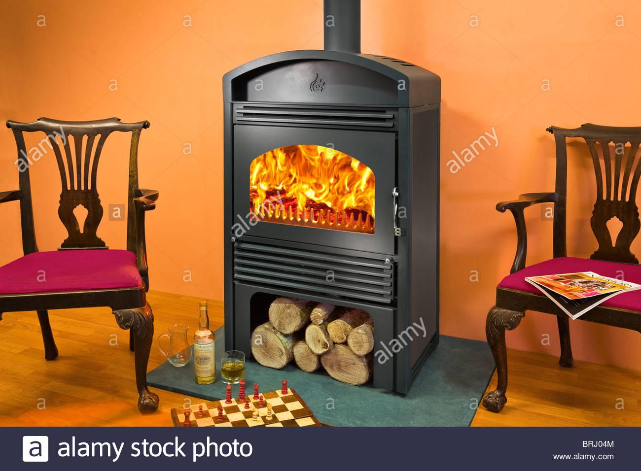 a woodfire c18 wood burning stove with log store below BRJ04M