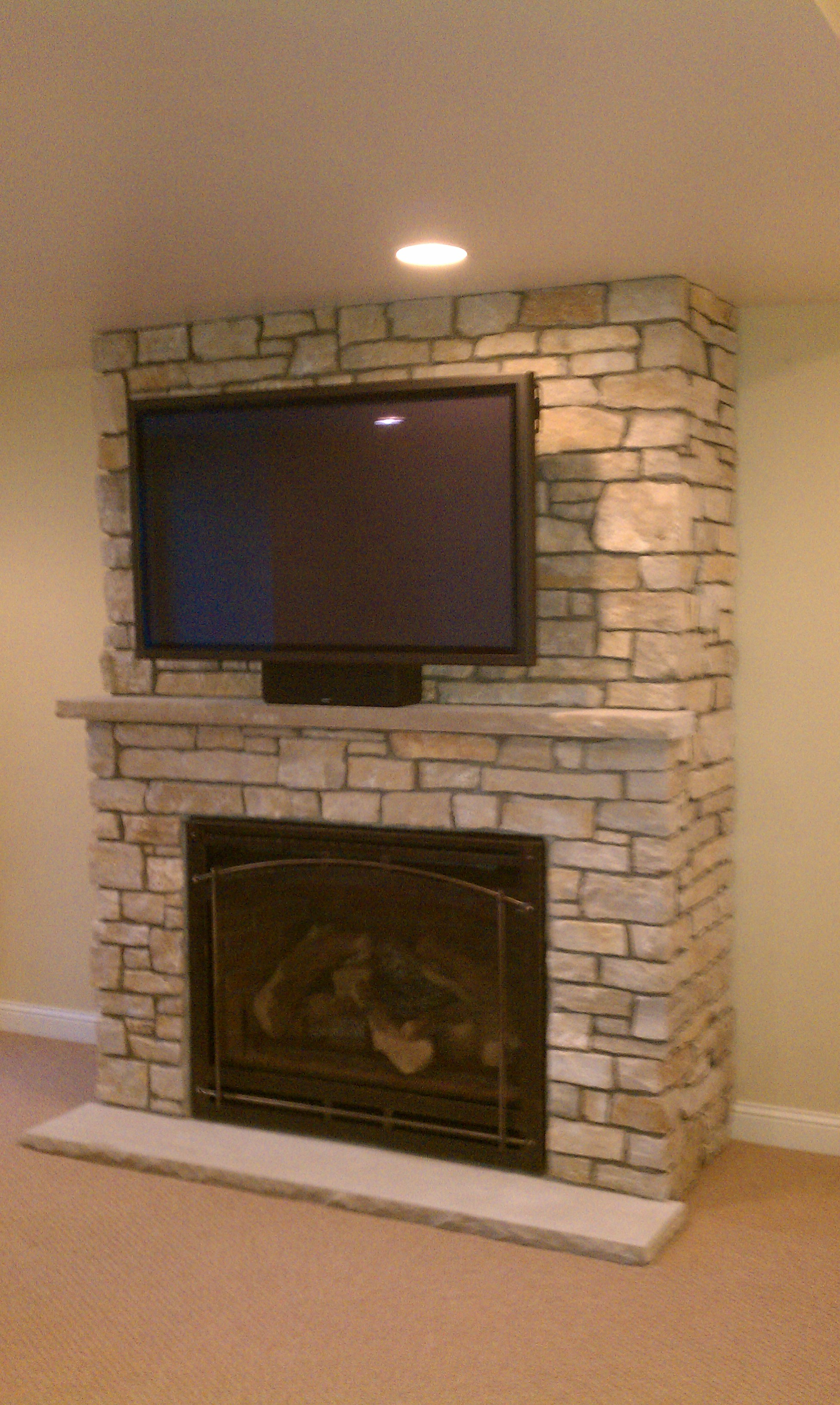 recessed lighting and interior paint color with stone fireplace ideas plus tv over fireplace also carpet flooring for beautiful modern living room elegant fireplace ideas covering brick fireplace with