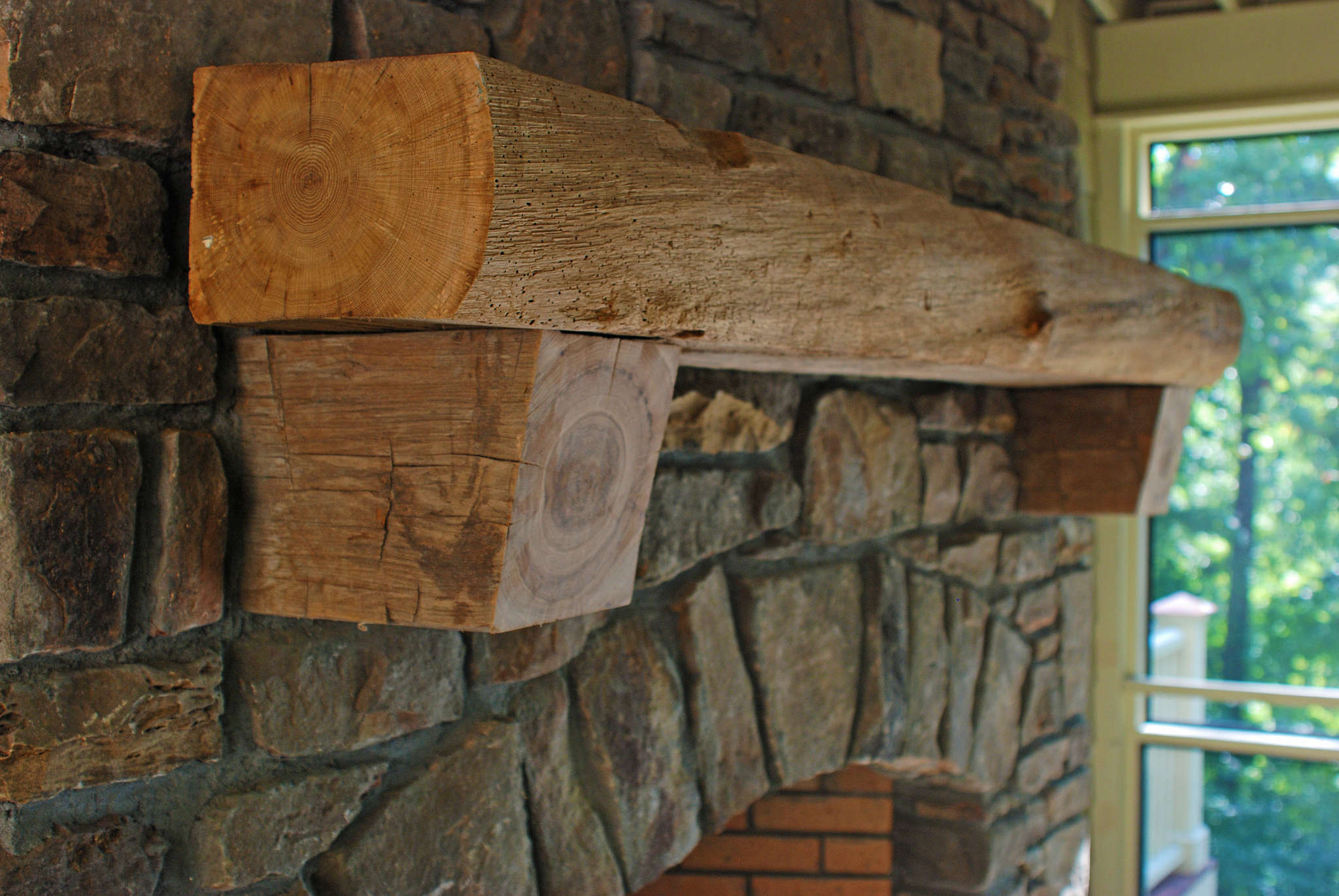 rustic live edge fireplace mantel with end grain corbels 1