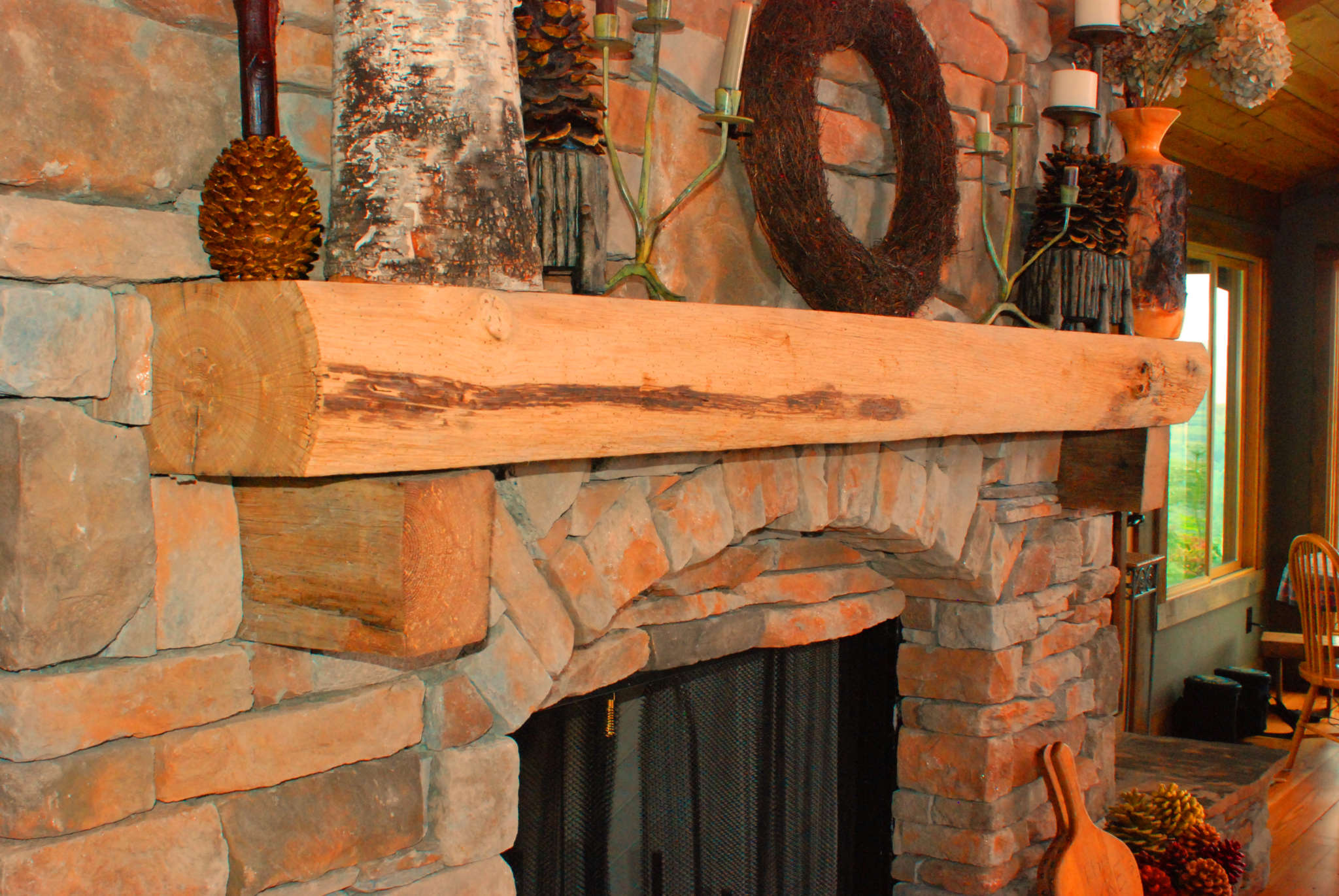rustic live edge mantel corbels over stone fireplace in Black Mtn NC