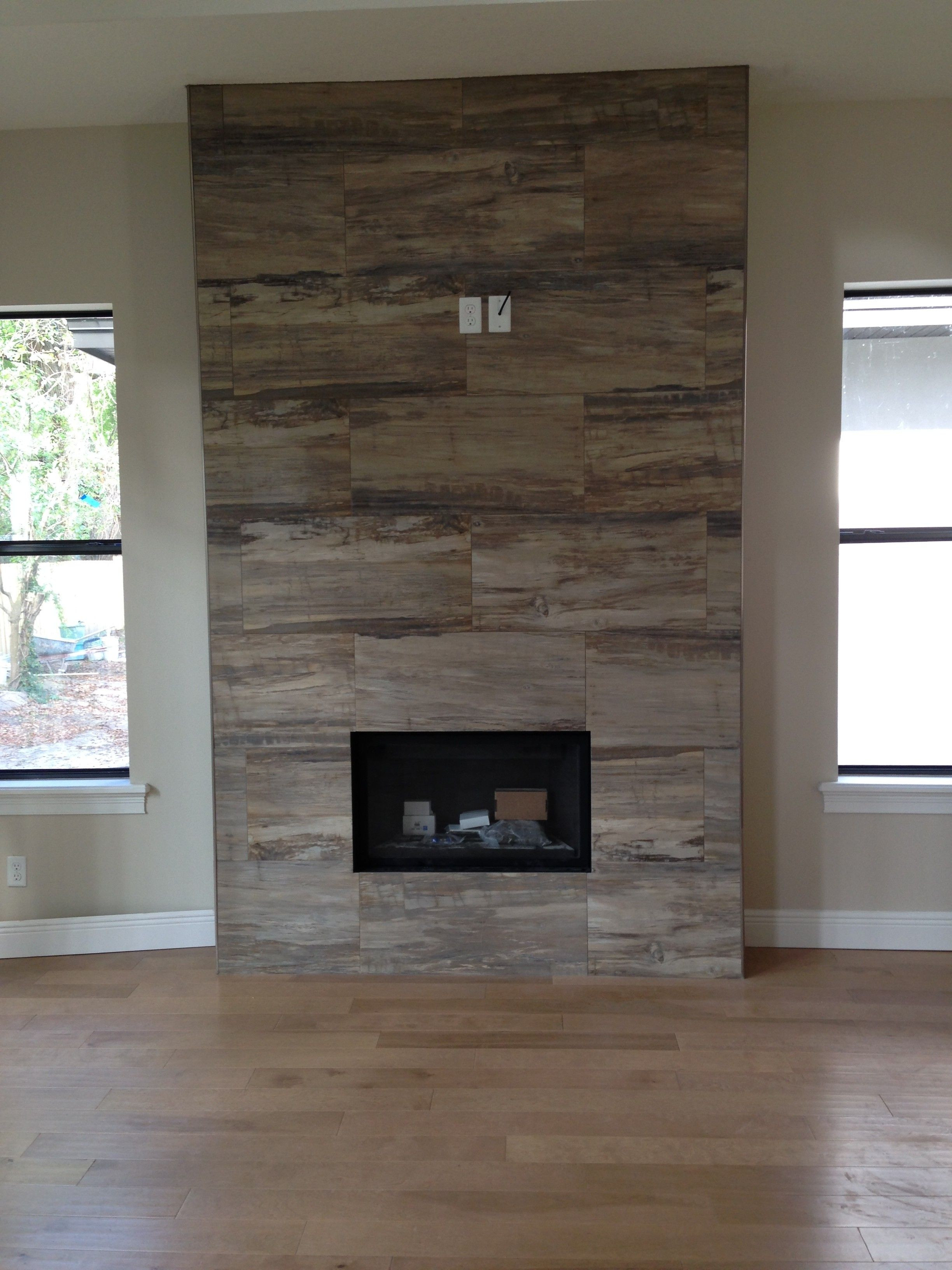 hardwood floors around brick fireplace hearths of j wood tile makes an absolutely stunning fireplace inspiration with j wood tile makes an absolutely stunning fireplace