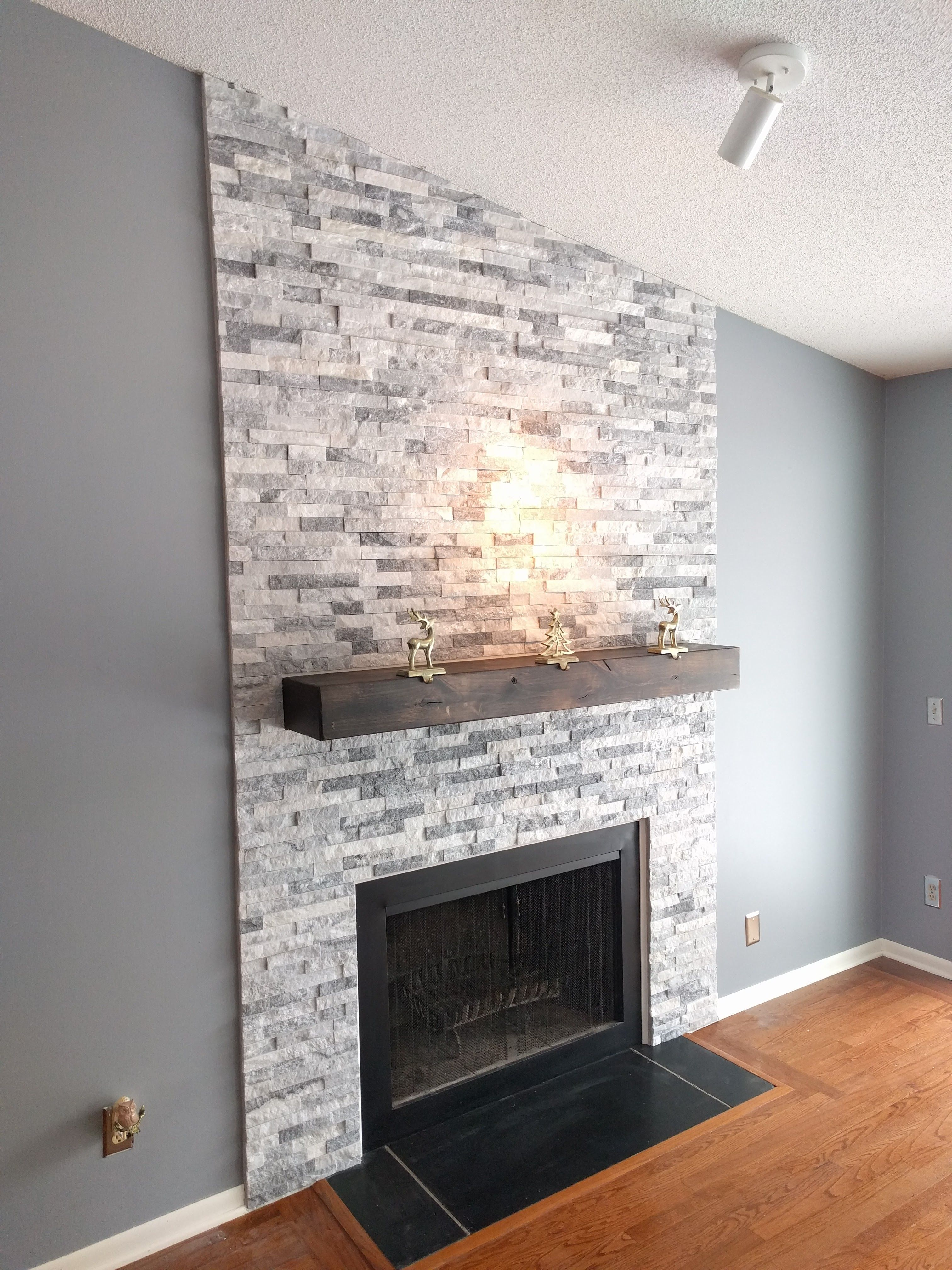 ceiling lighting with stone fireplace ideas plus wooden fireplace mantle and light grey painted walls also wooden floors for attractive modern living room design ideas brown fireplace decor tv over st