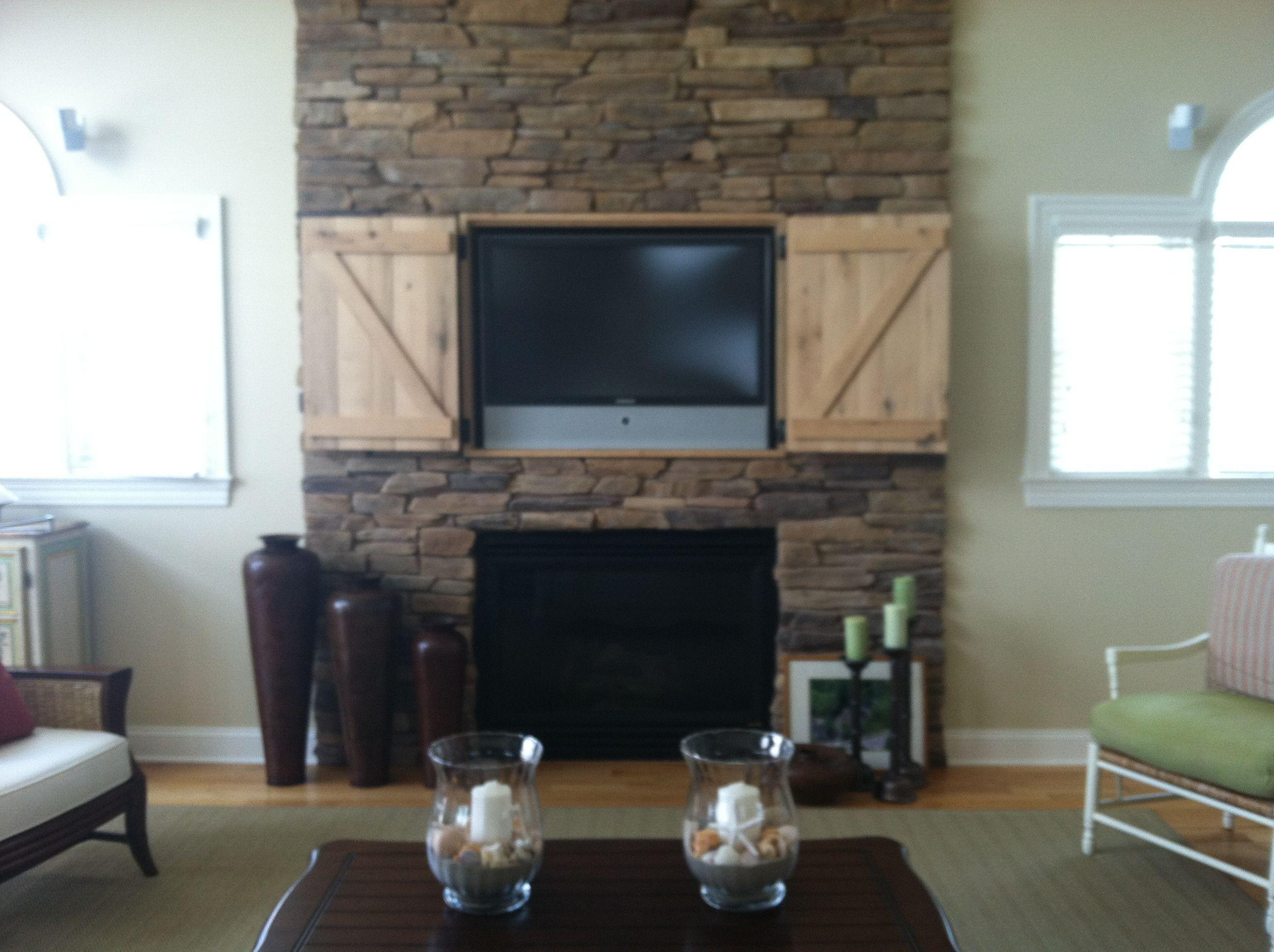 Tv Above Fireplace Decorating Ideas Elegant Hidden Tv Over Fireplace Open Doors Decor and Design