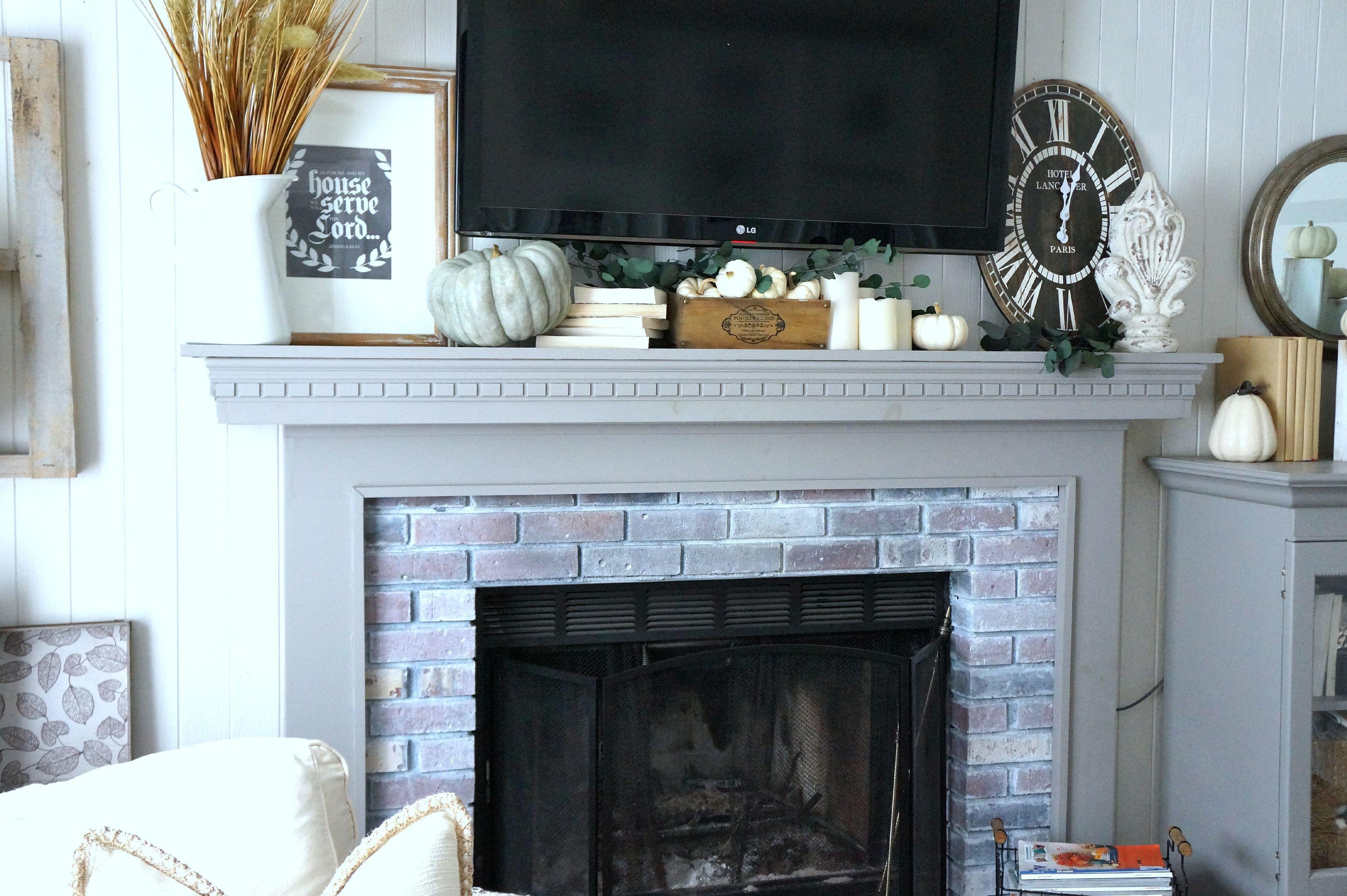 decorate fall mantel around TV a5f9b582c356d1f7b