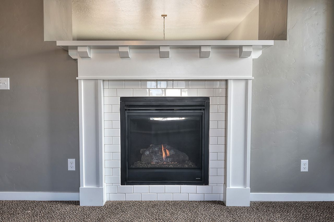 White Fireplace with Shelves New Cozy Up to This Fireplace Surrounded with White Subway Tile