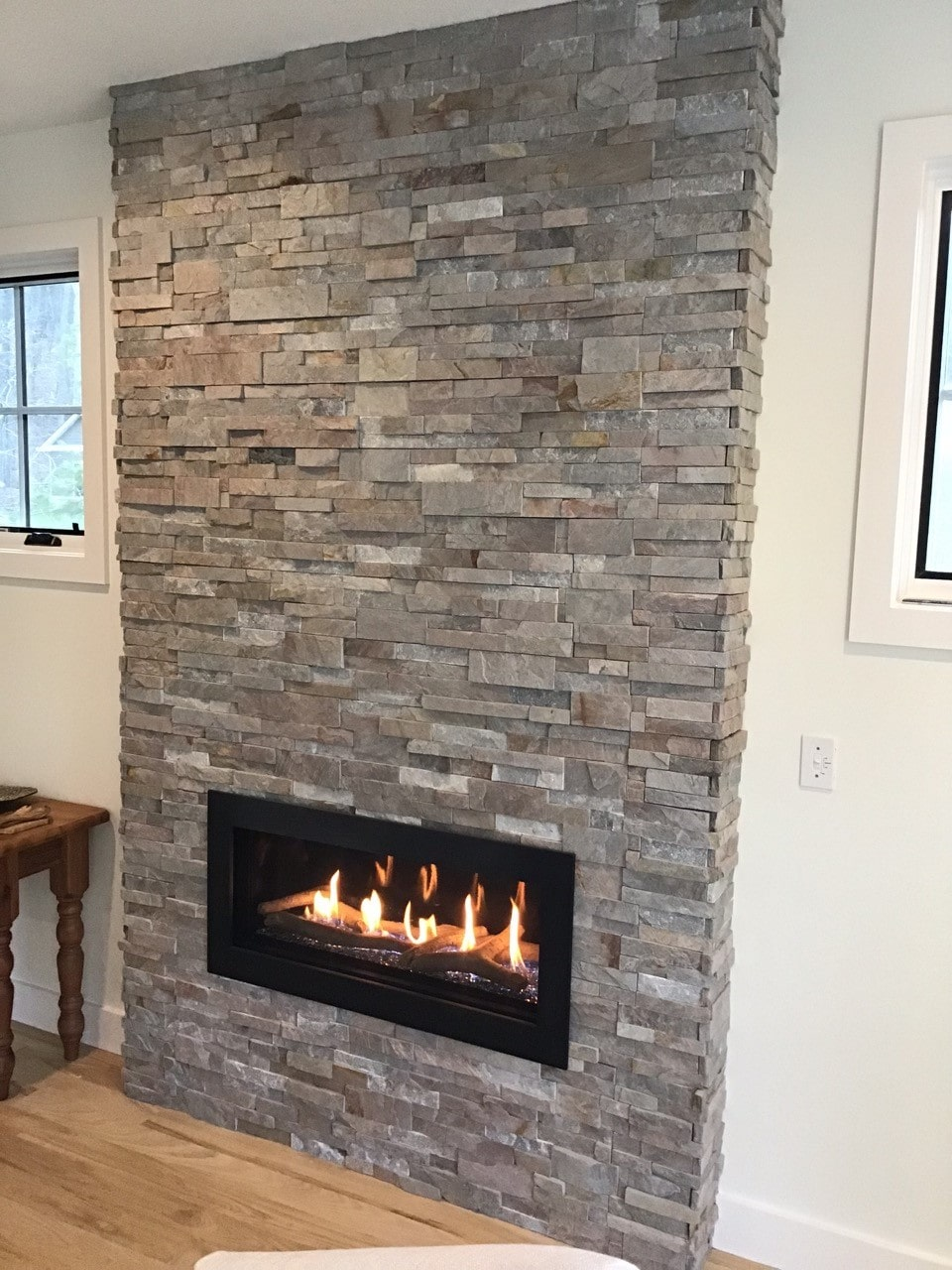 Sierra XLX Stacked Stone on Floor to Ceiling Fireplace