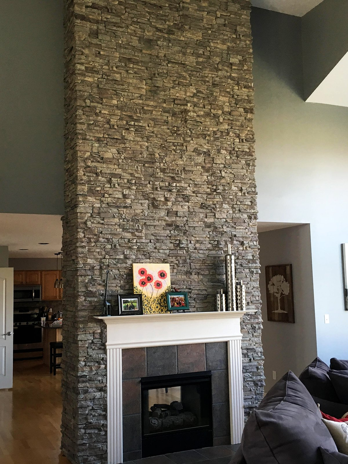 chic interior paint ideas and stone fireplace ideas with white fireplace mantle also cushioned sofa plus wood flooring for modern living room design mantel shelf ideas stone mantelpiece rustic outdoor