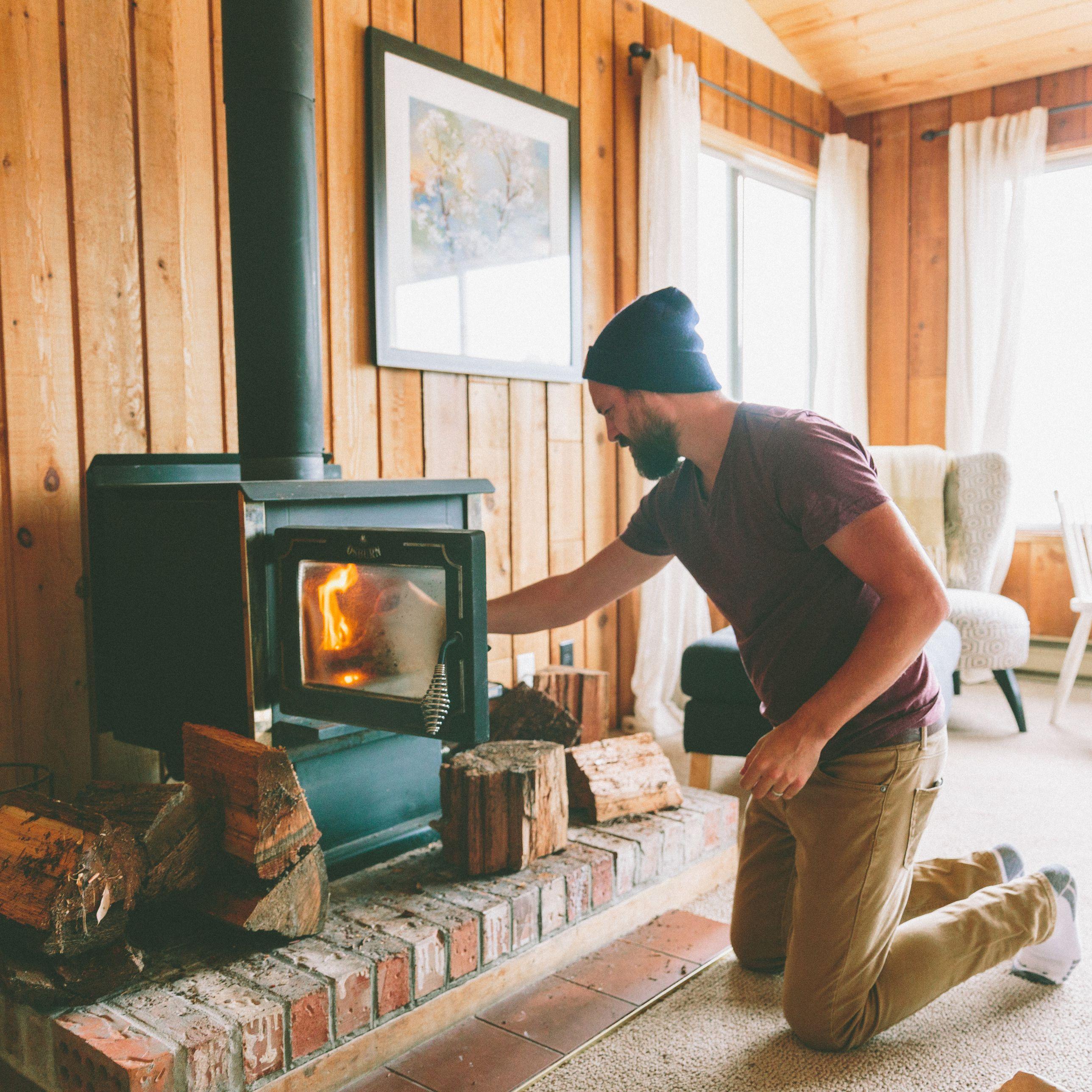man burning firewood at home 5bf36fb6c9e77c a2b2