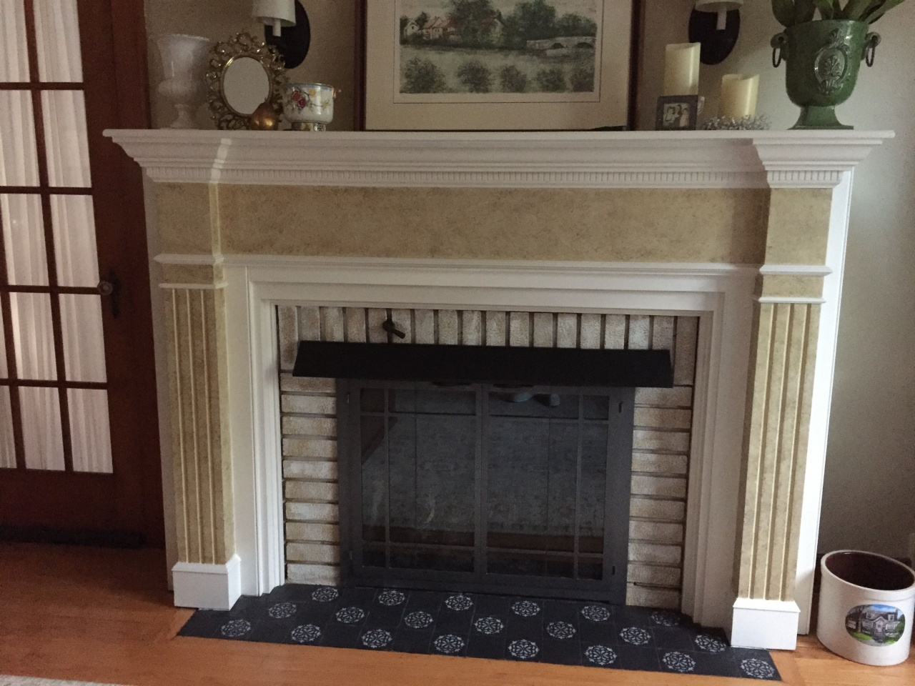 how to refinish a fireplace stencil over black tile just to jazz up the fireplace from how to refinish a fireplace