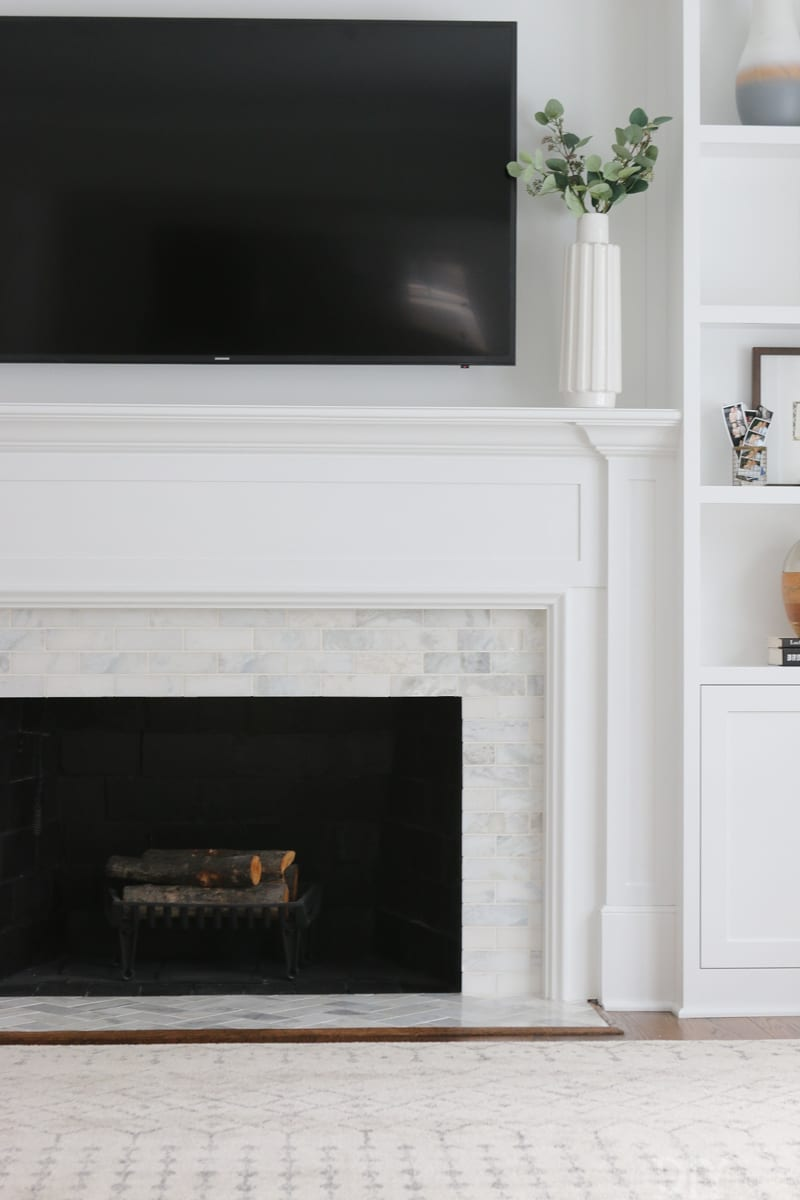 White Fireplace with Marble Tile