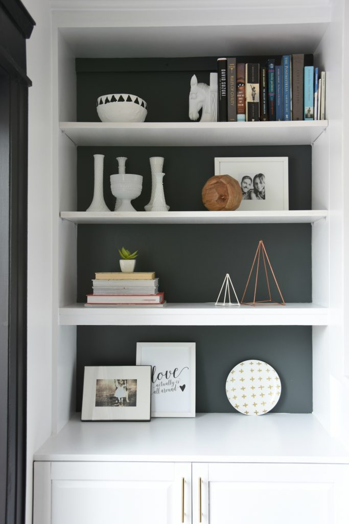 Make these DIY white and copper triangle sculptures out of skewers hot glue and spray paint Makes an amazing art piece to help style your shelves5