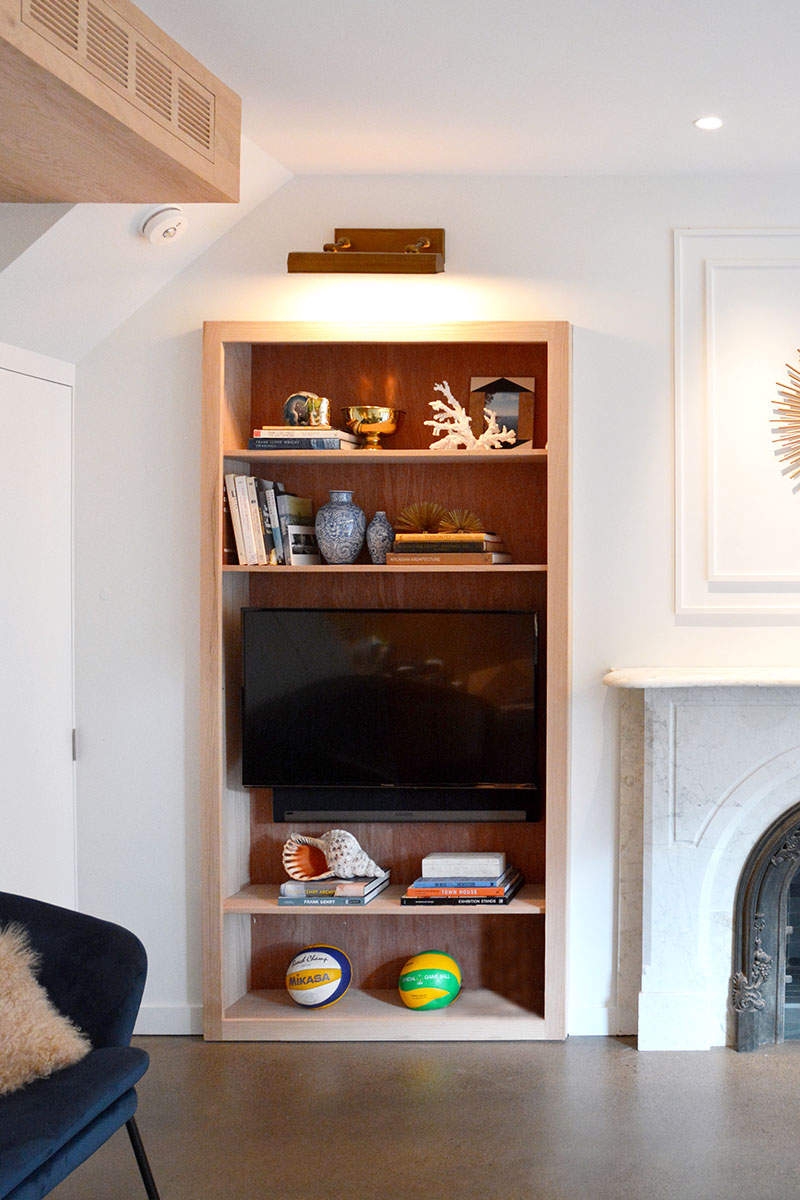 built in wood bookshelves around fireplace 158 03