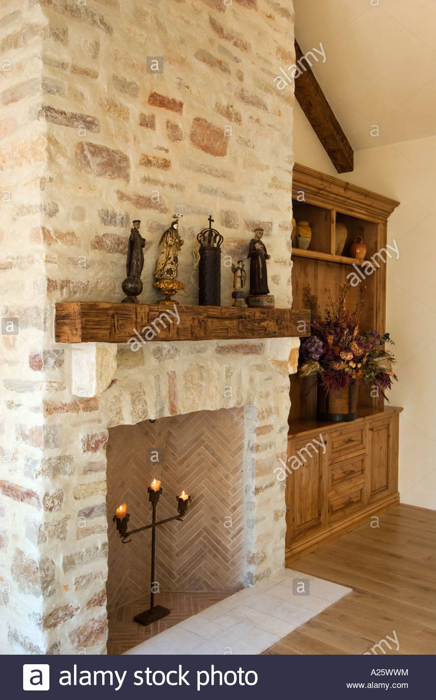 hard wood floor stone fireplace built in cabinets and statuary in A25WWM