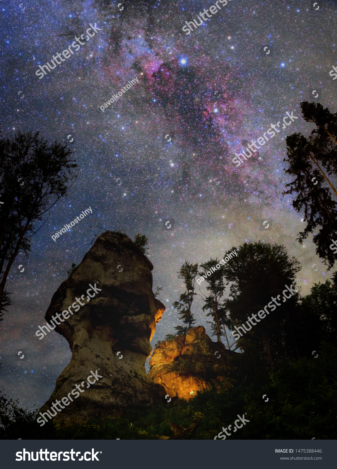 stock photo starry night dky over rocks with fireplace