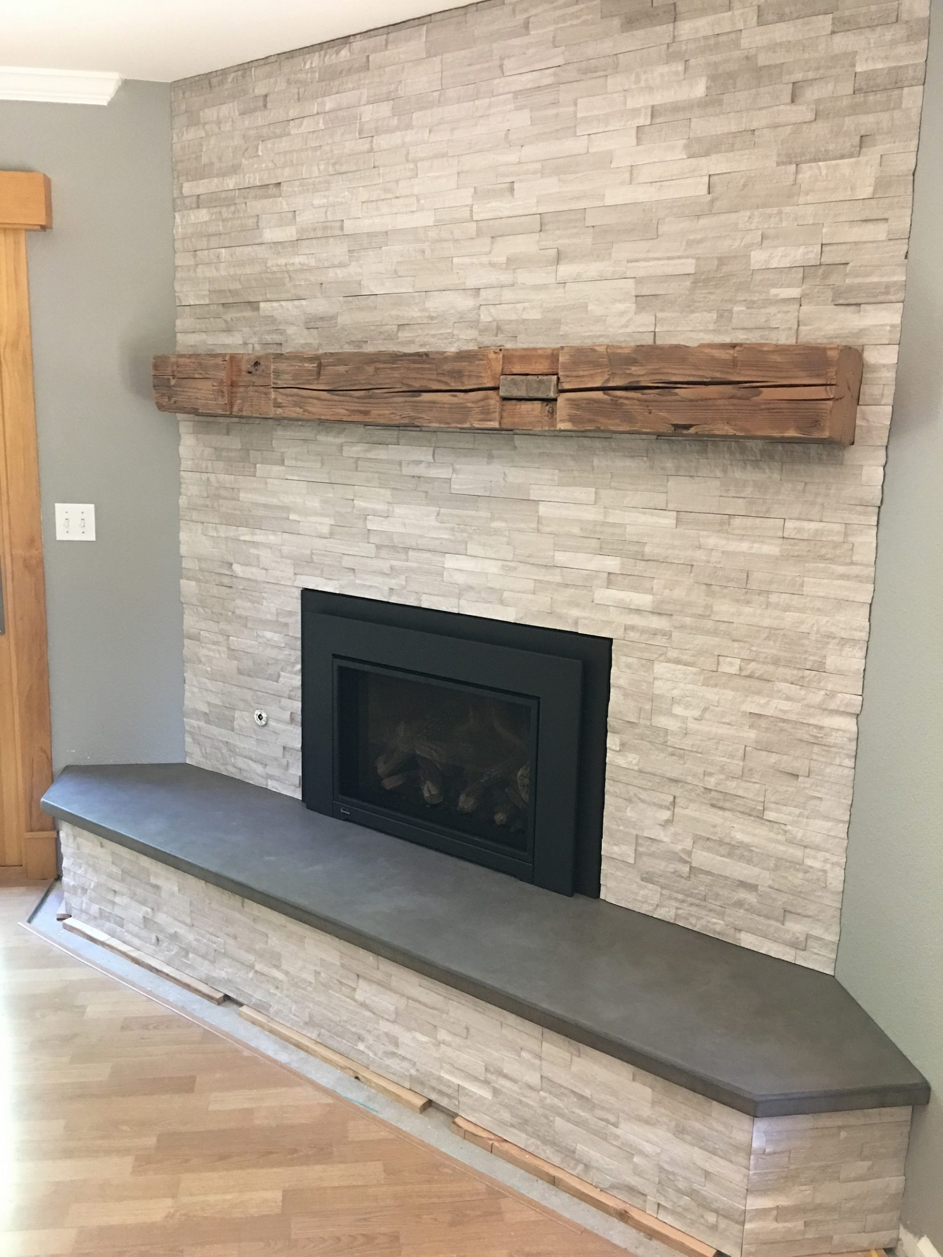 Black Concrete Hearth with Stone Fireplace 2