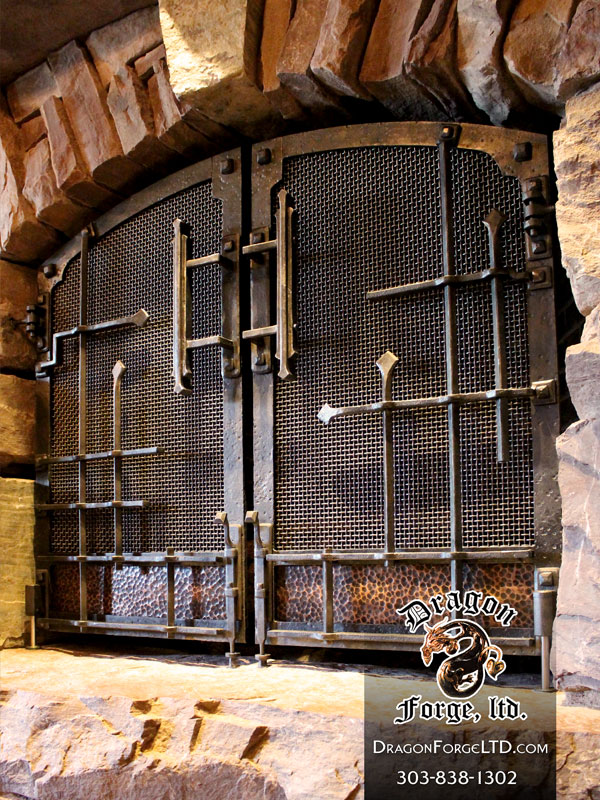 Great Northern Lodge modern rustic blacksmith fireplace doors