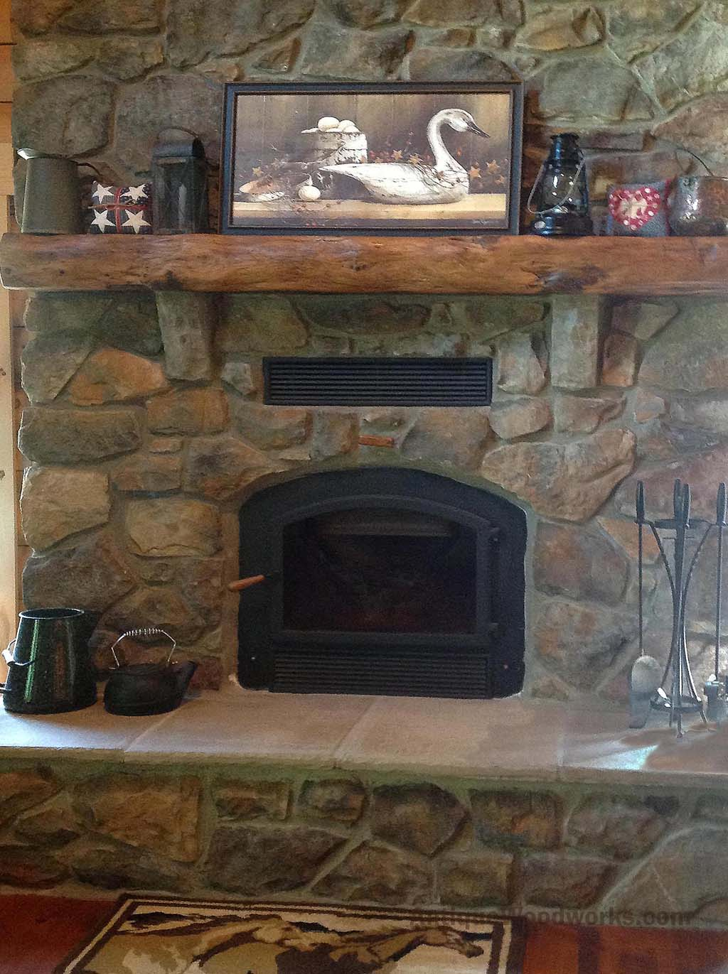 reclaimed log like fireplace mantel