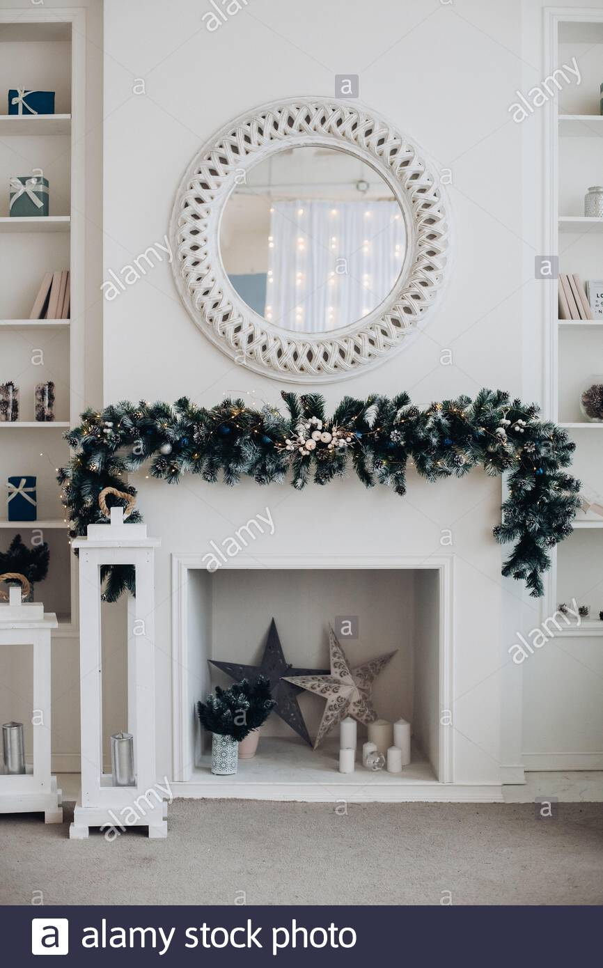 beautiful fireplace with mirror and fur branches 2AEB3G7