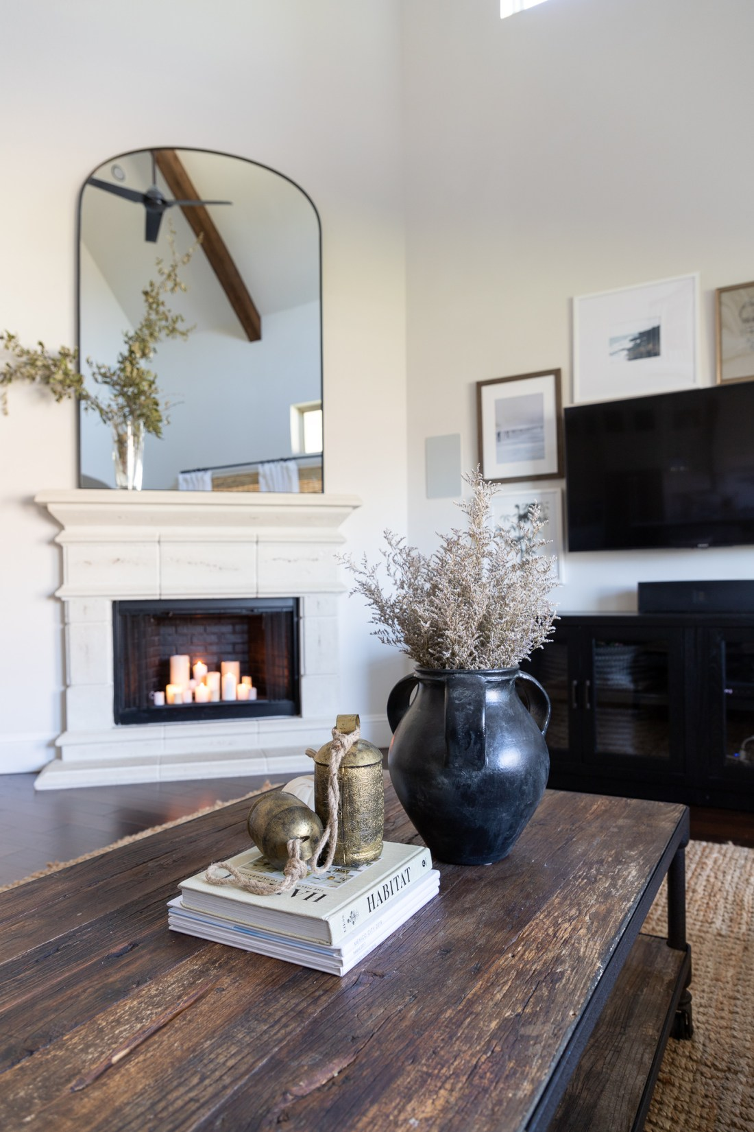 large arched fireplace mirror