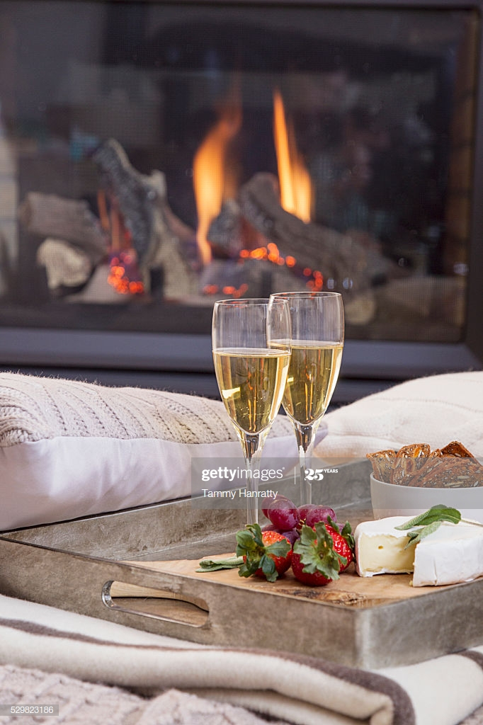 tray with champagne flutes on sofa fireplace in background picture id