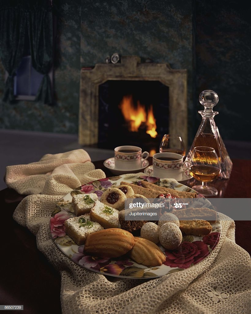 tray of cookies by fireplace picture id