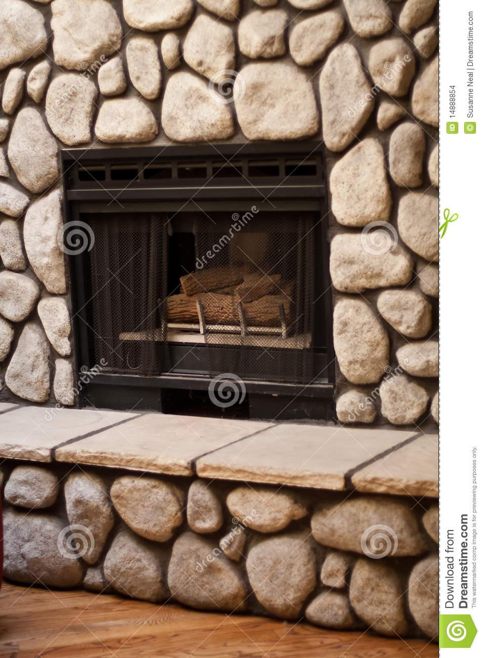 gas fireplace big rocks wall